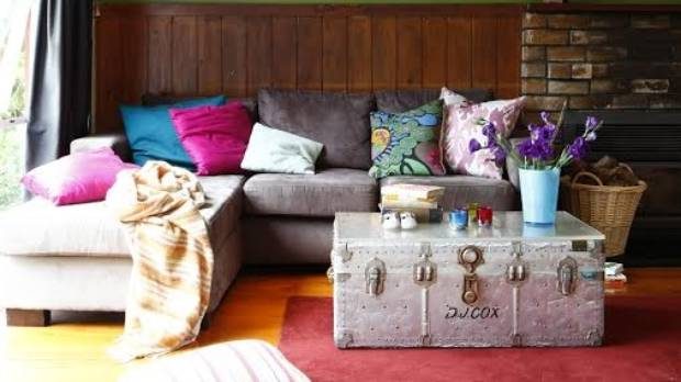 Wood, bricks and a cosy corner couch - what a cosy living room in which to while away a winter.