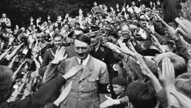 Adolf Hitler walking among the crowd of partisans, in front of his country house in Obersalzberg, Bavaria, Weimar Republic.
