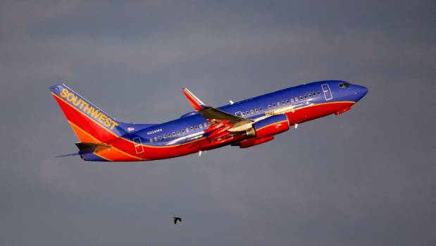 Southwest flight makes emergency landing after flames shoot from engine