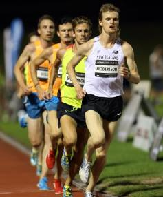 OVERCOMING THE PAIN: Jake Robertson, running with a broken wrist, sets the early pace during the men's 5000m race at the ...