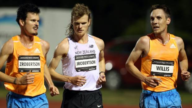 COMPARING NOTES: The Robertson twins Zane (left) and Jake (centre) chat with 5000m race winner Nick Willis during the ...