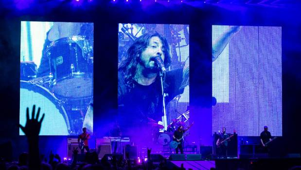 Dave Grohl and the Foo Fighters in front of a packed stadium in Sydney.