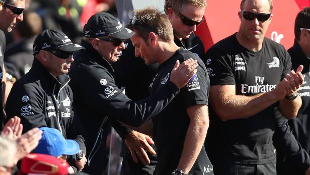 Barker is consoled by Team NZ boss Grant Dalton after they were defeated in the last race of the 2013 Cup match.