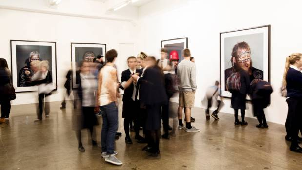 PREVIOUS SHOWING: Gallery patrons view the 'Mongrel Mob Portraits' at the Gow Langsford Gallery in Auckland.