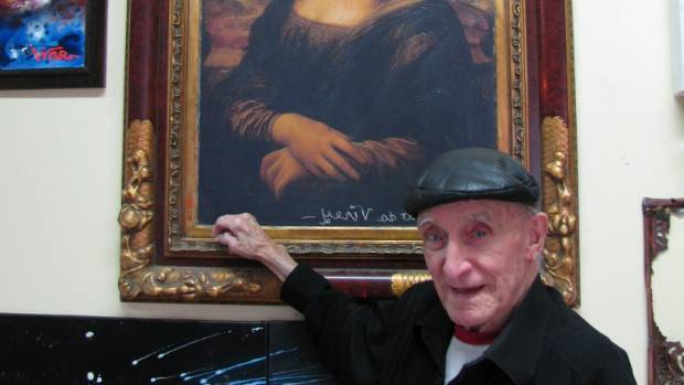 Carl Feodor Goldie, formally known as Karl Sim, signing Leonardo da Vinci's name on the reproduction of the Mona Lisa.