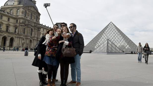 Selfie sticks may soon be banned inside the Louvre, the world's most visited museum.