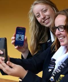 Gloria Harvey, left, and Lucy Blakiston, both 17, with Marlborough Girls' College's new app.