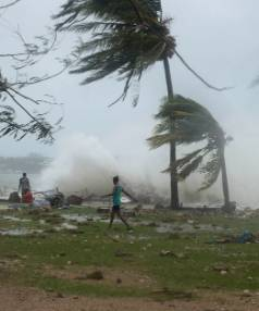 Waves and scattered debris along the coast, caused by Cyclone Pam, in the Vanuatu capital of Port Vila.