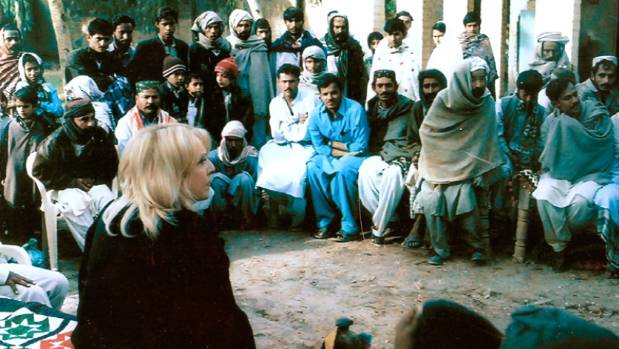 HONEST DISCUSSIONS: Linda Cruse talks with dairy farmers in Sindh province, Pakistan.