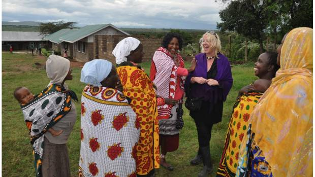 WORKING TOGETHER: Linda Cruse shares a laugh with women of the Maasai Mara in Kenya.