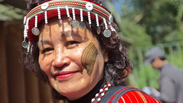 Staunch defender: Retired teacher Yungay Isaw dressed in traditional Atayal attire.
