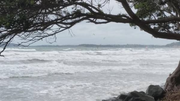 Large swells roll in at Orewa Beach, north Auckland.