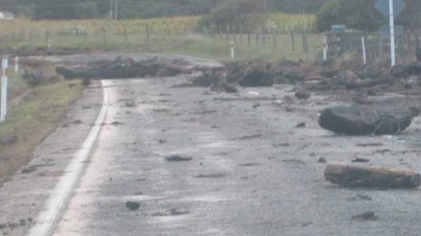 A boulder lies on the road  in Omaio, Bay of Plenty.