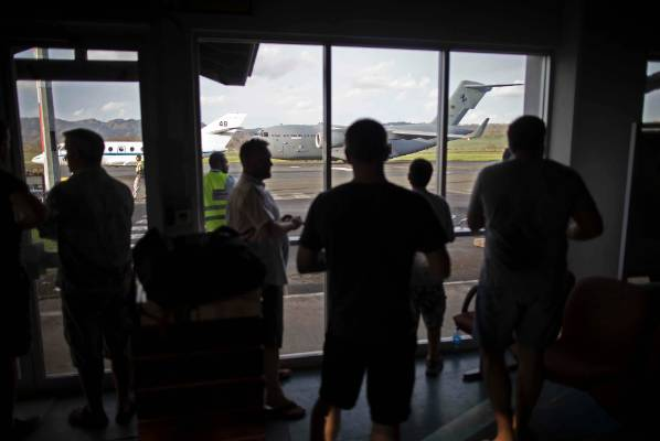 Stranded Kiwi holidaymakers pictured at Port Vila airport waiting for a commercial flight out.
