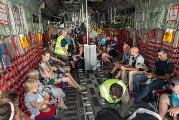 New Zealanders are evacuated from Port Vila back to Auckland on a RNZAF C-130 Hercules aircraft.
