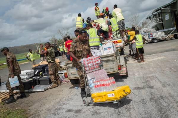 Vanuatu military personnel prepare aid for distribution at Port Vila airport.
