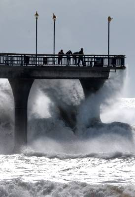 Surfs Up. New Brighton Pier Christchurch starting to take a hammering from swell generated by Cyclone Pam.
