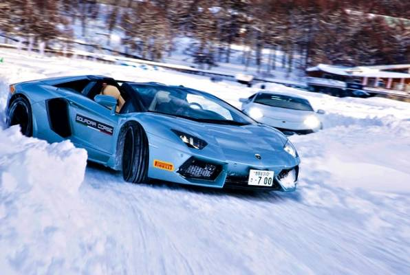 FOLLOW ME: Aventador Roadster Slips Through The Snow Banks.