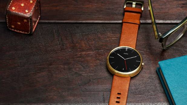 Smart looking: The Moto 360 looks like a conventional watch but is in fact a smartwatch, with a customisable fashion ...