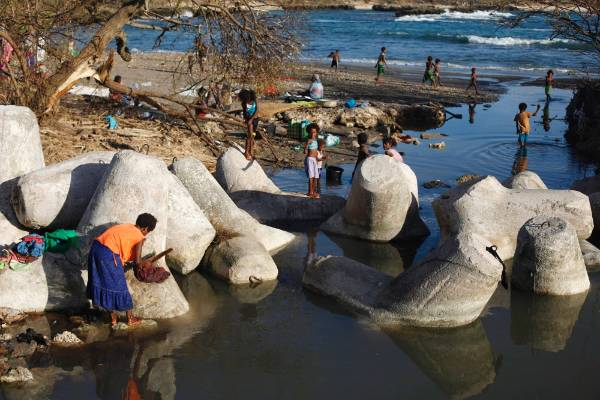 People wash their clothes on the beach at Lenakel town in Tanna,Vanuatu.