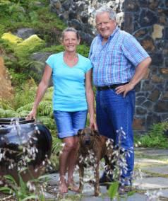 MEET THE TEAM: Gardener Karen Pinnington and landscape designer Bill Holden, with Karen's dog Red.