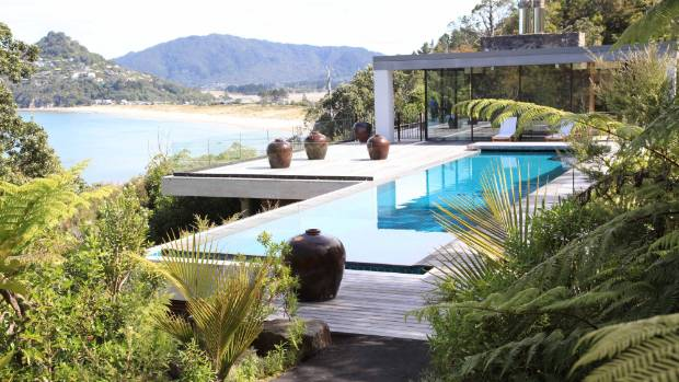 WHAT A VIEW: The garden design uses the existing pohutukawa trees to frame the house.