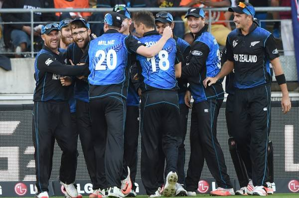 OLD FIRM: Black Caps captain Brendon McCullum cuddles Daniel Vettori after his stunning one-handed catch in the CWC ...