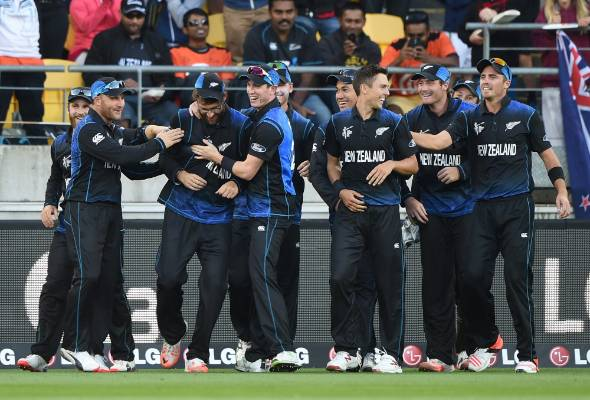 ONE OF THE BOYS: The Black Caps gather round Daniel Vettori after his sensational catch to dismiss Marlon Samuels.