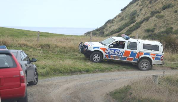 Police head onto a cliff top on private land near Curio Bay in their search for missing Invercargill school boy Mike ...