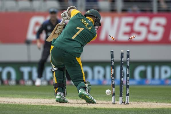 South Africa's Hashim Amla plays a Trent Boult delivery back onto his stumps.