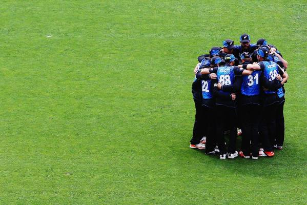 The Black Caps huddle prior to taking to the field at Eden Park.