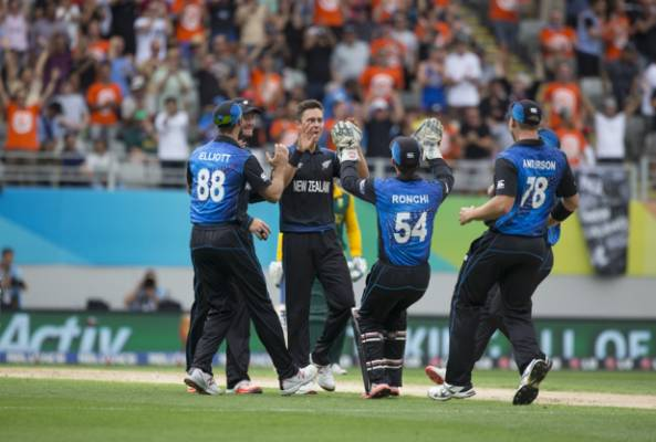 Trent Boult (centre) is congratulated after taking South Africa's first wicket.
