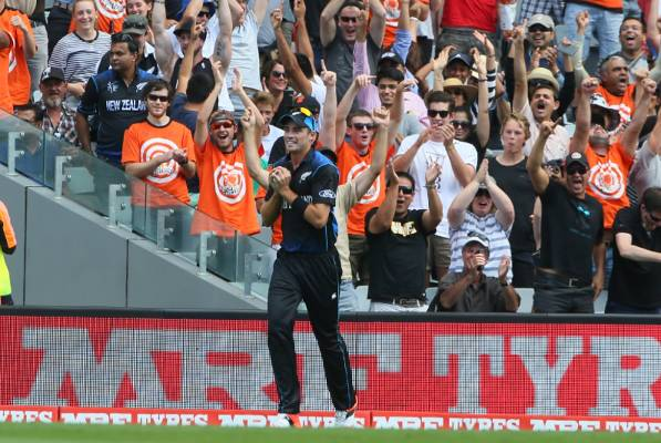 Tim Southee and New Zealand fans celebrate his catch to dismiss Quinton de Kock.