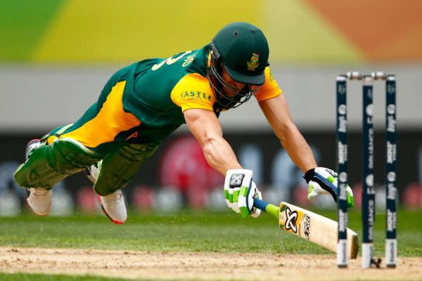 Faf du Plessis dives back into his crease during a run out chance.
