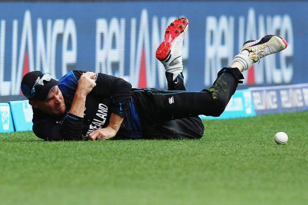 New Zealand captain Brendon McCullum dives in the field to prevent a boundary.