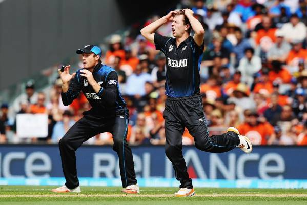 Bowler Matt Henry (right) and Martin Guptill react after a near-miss in the field.