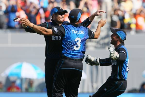 Martin Guptill (left) is mobbed by Ross Taylor and Luke Ronchi after his one-handed catch to remove Rilee Russouw.