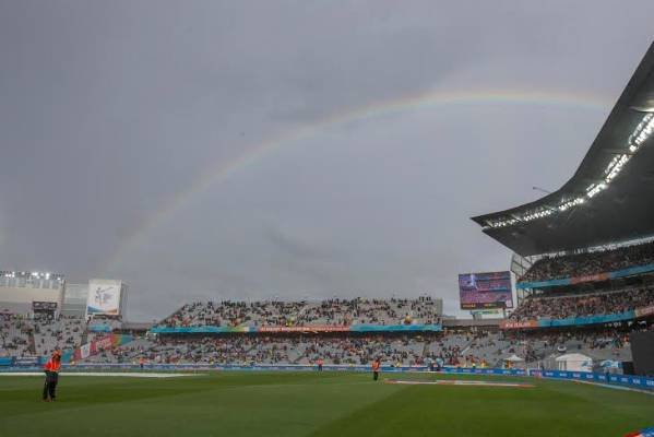 A rainbow forms over Eden Park just before play resumes after a rain delay.