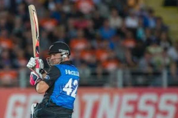 Brendon McCullum watches as he sends another delivery to the boundary.