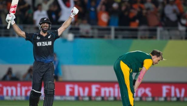 Grant Elliott celebrates after hitting a six to send New Zealand into the World Cup final.