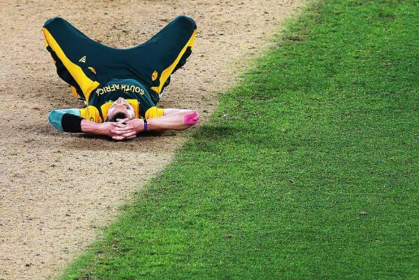 Dale Steyn collapses to the ground after South Africa are pipped by the Black Caps.