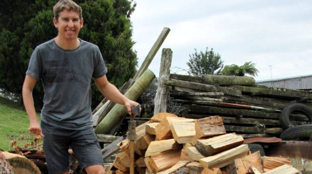 CHOP IT UP: Stephen Hills is selling wood to raise funds for an overseas cycling event.