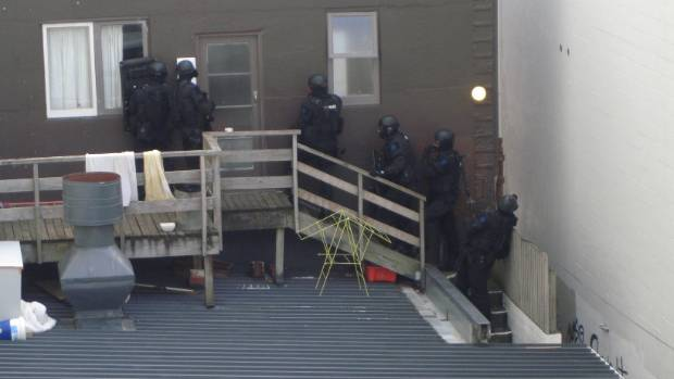 Armed police were seen entering an apartment on Kent Terrace.