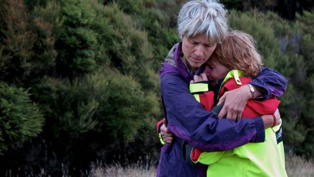 The mother of missing Dutch tourist Ken Boogers, Ine van der Linden, is comforted by Silvia from Victim Support.