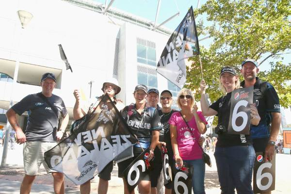 Black Caps supporters pose as they arrive for the Cricket World Cup final between Australia and New Zealand at the ...