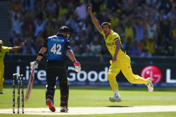 Mitchell Starc of Australia celebrates taking the wicket of Brendon McCullum of New Zealand during the Cricket World Cup ...