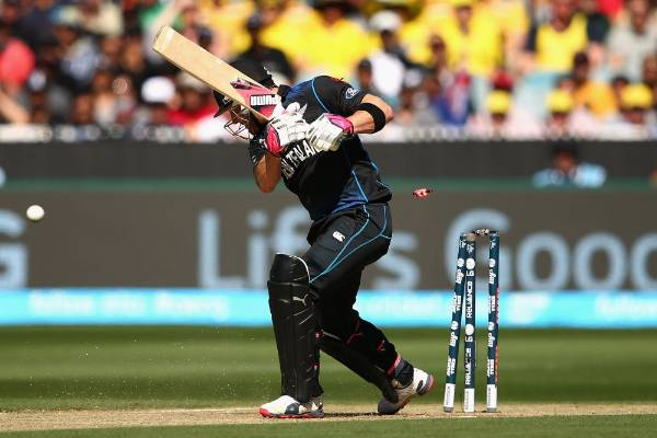 Brendon McCullum of New Zealand is bowled out by Mitchell Starc of Australia in the opening over of the Cricket World ...