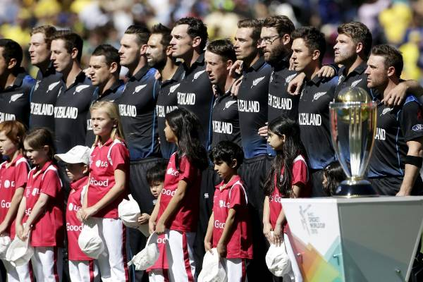 Black Caps captain Brendon McCullum (right) stands with his team mates during the playing of the national anthems before ...