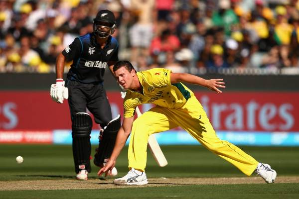 Aussie quick Josh Hazlewood fields his own delivery during the Cricket World Cup final at the MCG in Melbourne.