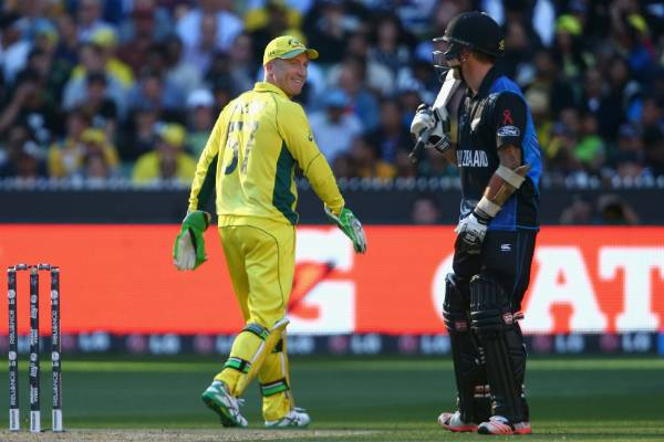 Brad Haddin of Australia smiles as he passes rival wicketkeeper Luke Ronchi during the Cricket World Cup final at the MCG.